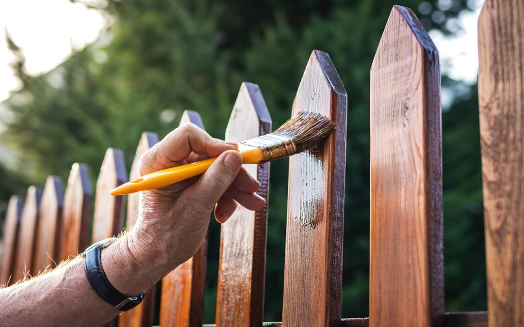 What are the benefits of sealing and treating a fence?
